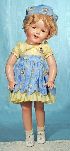LARGE FLIRTY-EYED SHIRLEY TEMPLE COMPOSITION DOLL.