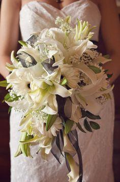 All white cascade bouquet - Lilies, calla lilies, gerbera daisies.