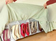 Use a bed skirt and sew on squares of material to create little pockets. Adjust the skirt under your mattress and tuck away your shoes. With an extra long duvet cover, you'll never see them showing but when you pull it up, Peekaboo, there's a shoe!