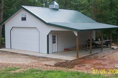 Decor & Tips: Amusing Pole Barn House Plans With Garage Door And Corrugated Metal Roofing And Porch