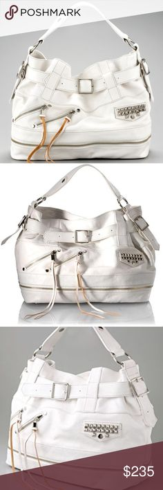 "Rebecca Minkoff Easy Rider Devote Leather HoboTote Tough luxe—studs and zippers lend biker edge to buttery pebbled white leather handbag.  Tonal topstitching. Silver hardware. Handle with rings; 7"" drop. Belted detail cinches magnetic snap top. Two angled zip pockets with long pulls; Tassel pulls at zips; studded magnetic-flap pocket. Zip detail around bottom. Blue and Black Polka-dot fabric lining. Inside, one zip, and two open pockets w key hook. Metal feet protect bottom of bag. 11 1/2""H…"