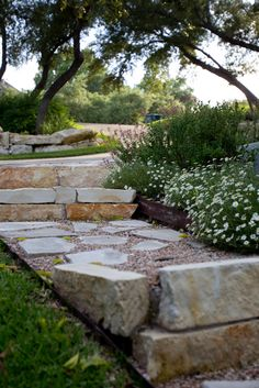 LOVE this walkway! Steps down a hill with LUSH flowerbed flowing into the walk. :)