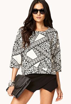 *** Cool cut. Cool pattern. Would this look good on me? Not sure if I could pull it off. I've always been weird about 3/4 sleeves... But I am thinking it's time to give them a second chance. ***