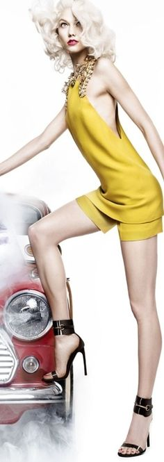 Karli long legs in a yellow dress and high heels