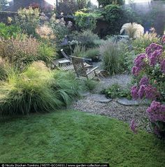 Garden lounge with grasses and gravel.