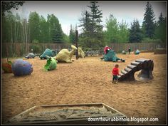 """The giant sand pit and activity area at Edmonton's Jurassic Forest. Find out more at """"Down the Wrabbit Hole - The Travel Bucket List"""". Click the image for the blog post."""