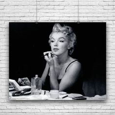 ABOUT THE ITEM - Marilyn Monroe Elegant Photography Make-up in front of mirror. Own this Marilyn Monroe photography print poster Ideal for