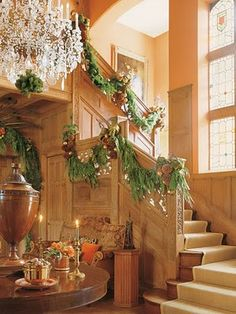 Garland on panelled staircase - Interior Designer, Mary McDonald - from Veranda Magazine - photographer Miguel Flores-Vianna