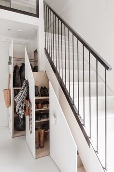 Under Stair Storage Ideas for Small Living Spaces | This is the storage solution if you feel like closet space in the bedroom or rest of your home isn't enough. Your stairs can become the closet you need for clothes storage and more.
