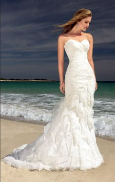 Beach Wedding Dress. lovely! and the picture is beautiful! :)