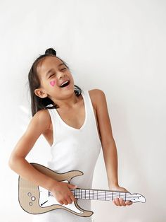 a DIY cardboard guitar for your rockstar in training.