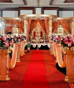 THIS is the overall look I want! =) I love the red and gold, the carving, the aisle way with blocking off  of the aisle from the seats.  Less floral, though.