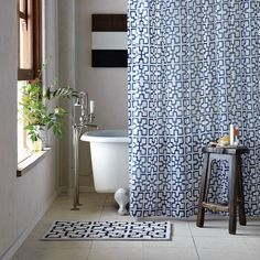 Pretty blue patterned curtain. From West Elm here: http://www.westelm.com/products/trellis-shower-curtain-b639/?pkey=cbathroom-furniture-accessories