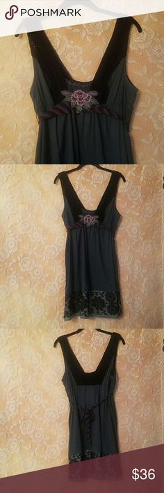 """ANTHROPOLOGIE FREE PEOPLE TOP/DRESS DK. GREEN SZ 8 ANTHROPOLOGIE FREE PEOPLE TOP OR DRESS SIZE 8 DARK GREEN WITH BLACK DETAIL  MADE IN INDIA  CABLE KNIT DETAIL ON BODICE  EMBROIDERY TRIM ON HEM MULTICOLOR SASH TIES IN BACK  ARMPIT TO ARMPIT- 18"""" ELASTIC UNDER BODICE  LENGTH- 34"""" Anthropologie Tops Tunics"""