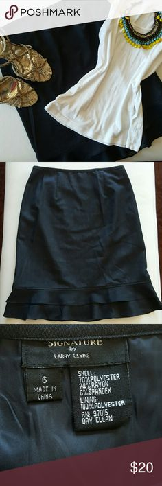 """LARRY LEVINE   PENCIL SKIRT * Straight skirt with ruffled hem adds a twist! * Color is a dark indigo blue * Flat waist allows for blouses to be tucked in or out * Modern midi length, perfect for office/church * Hidden side zipper  * Poly/rayon/spandex blend * Fully lined * Pristine condition   Length 22.5""""   Waist 29-31""""   Hips 38-40""""  Reasonable offers always considered. Over 175 items listed so bundle to save more. Ask for a quote anytime! Larry Levine Skirts Pencil"""