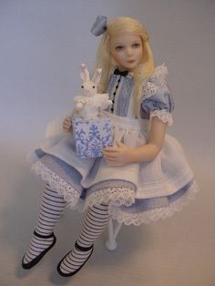 A 1:12 scale Alice created from porcelain with her Bunny Jack-in-the-Box. She is about 4 inches high and currently available from my CDHM.org online gallery. Debbie Dixon-Paver