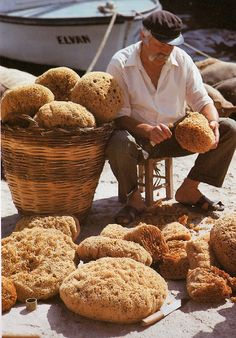 Greek sponge man in Kalymnos, large even  holes in the sponge makes it last longer and wash in vinegar!