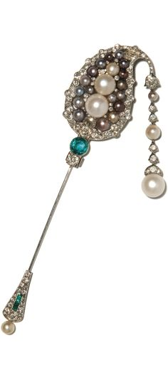 Natural pearl, emerald and diamond jabot pin, Cartier, 1920s. Of Indian inspiration, set with natural pearls of various colours, a circular-cut emerald, cushion-shaped, circular-cut and rose diamonds, suspending a line of diamonds and natural pearls; the keeper set with circular-cut diamonds, calibré-cut emeralds and a natural pearl, signed Cartier, numbered, French assay and maker's marks, case signed Cartier.