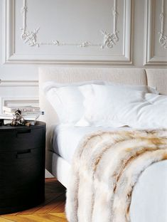 luxe bedroom, white ornate trim, with statement bedsides and lots of texture