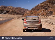 Rented Car Parked Off Desert Road Covered In Dust Stock Photo, Royalty Free Image: 80893382 - Alamy