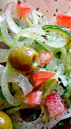 Zesty Italian Cucumber Salad:// Ingredients 3 cucumbers, spiralized into noodles 1 chopped tomato ¼ fined diced onion ¼ cup of green olives ¼ cup chopped nitrate free pepperoni ⅛ cup Parmesan cheese 1 tbsp. oregano ¼ tsp black pepper Italian dressing* (you want enough to coat and marinade the salad) Instructions 1.Add ingredients and toss in a bowl 2.Let stand in the refrigerator for an hour before serving