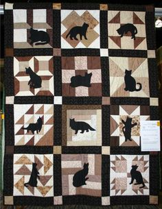 my parents have a quilt like this (obviously not with cats) that has little vignettes in each square, might be nice to recreate?