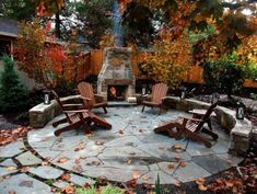 round patio with fireplace and stone walls