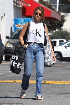 Casually attired: The actress, 26, wore a pair of high waist jeans paired with a…