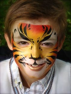 Face painting is always considered a huge hit with boys and girls. There are various easy face painting ideas for boys, which you can choose and try. Face Painting Images, Face Painting For Boys, Face Painting Designs, Tiger Face Paints, Boy Face, Child Face, Face Paint Makeup, Belly Painting, Rainbow Painting