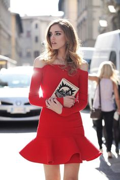 Chiara Ferragni turns heads in this off-the-shoulder flared red dress and book box clutch
