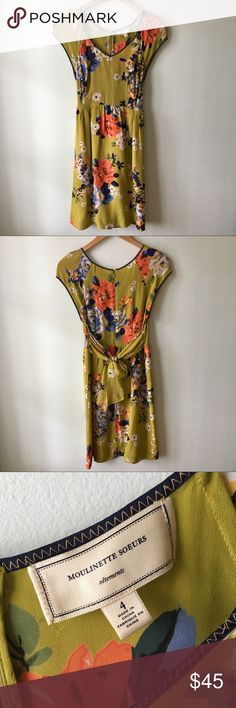 Anthropologie Moulinette Soeurs Silk Floral Dress In excellent condition. Only flaw is that the tag is detached on one corner, does not affect the dress. Skirt is fully lined. Beautiful colors, they just didn't suit my skin tone well so I hardly wore this. Anthropologie Dresses Midi