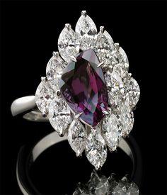 Richard Krementz Gemstones - Alexandrite and diamond ring. Love this asymmetrical cut.