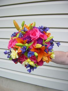 Jewel toned wedding: Brightly colored mix of flowers for this bride!  Designed by WhimsicalWelcomes.com  Skippack, PA
