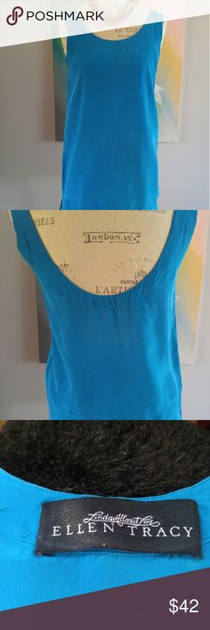 """SILK TURQUOISE TOP Sumptuous designer  Silk Turquoise Tunic. Great over jeans And heels or by itself as a body skimming mini dress. Fun with flats or booties. Super wow! I'm 5""""2 and it hits me mid thigh. Ellen Tracy Tops"""