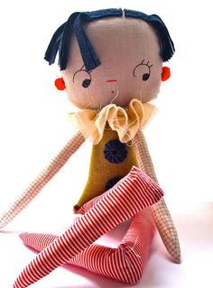 Cloth rag doll art doll retro circus carnival cartoon baby yoyo doll. £79.00, via Etsy.
