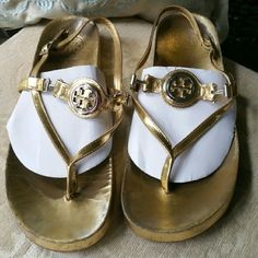Tory Burch Gold Leather Thong Sandals Size 7.5 Very Good Pre-owned Condition! Interior lining wear consistent with use. Not seen while worn. Tory Burch Shoes Sandals