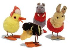 FOUR STEIFF POM-POM ANIMALS IN SLIPPERS: yellow Duck with white pom-pom and red bonnet, (1506), 1931-43 --2in. (5cm.) high; Bumble Bee, celluloid wings, (1506), 1938-1943 --2in. (5cm.) high; grey Mouse, (4509,2), red top, leather tail and FF button, 1936-42 --2¾in. (7cm.) high; and boy rabbit from Rabbit Couple, (4509,1), light brown, red and white wool and FF button, 1936-41 --2in. (5cm.) high | Private Collections & Country House Sales Auction | 20th Century, All other categories of…