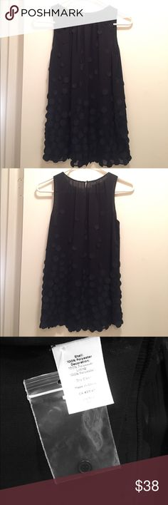 FLIRTY Little Black Blouse with Embellishments! Sleeveless FLIRTY black blouse with circle embellishments placed throughout and concentrated along the bottom. Such a unique and fashionable piece! High neck, slips over head, tiny button to secure the neck in the back. TAG WITH EXTRA BUTTON ATTACHED! Talbots Tops Blouses