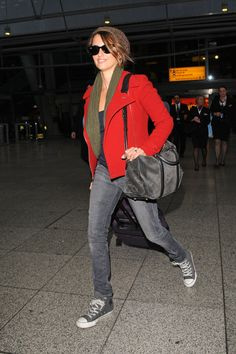 """Airport Style - Penelope Cruz kept it comfy while traveling, opting for a pair of gray, white lace up """"Chuck Taylors"""". - Converse All Stars"""
