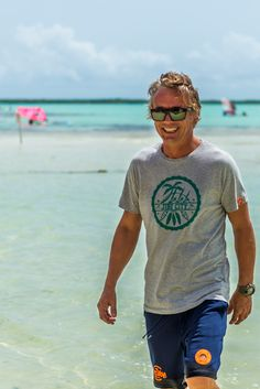Imagine yourself surfing on the blue waters of Lac Bay, paradise in its most pure form, many surf groms were born on these clear waters.  Gert Jan manager of Jibe City and coach of the groms. He is allways there when you need him.     Designed by Willem Cattersel exclusively for Jibe City and Hole.  This shirt is made of 100% light cotton, single jersey 160 gr and garment washed. Sunny Beach, Cotton Lights, Fashion Brand, Beachwear, Surfing, Paradise, Pure Products, Shorts, City