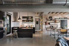 HAO Design Studio, taiwanese based firm created this apartment in Kaohsiung City, Taiwan for a couple, their three beloved cats, and their stuff. Subdued concrete instantly set the tone for the modern minimalistic industrial space or as we call it loft. Industrial Kitchen Design, Vintage Industrial Decor, Industrial House, Modern Industrial, Eclectic Modern, Modern Loft, Industrial Apartment, Loft Design, Design Studio