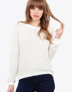 An oversized cream sweater with a waffle knit. Oversized fit. Crew neck.