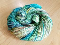 Melted Crayons is a beautiful handpainted/hand dyed yarn on our Glittering Luxe base - its a superwash merino wool/nylon/stellina fingering