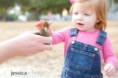 Laura and a baby duckling at the Lake Yard in Defuniak Springs