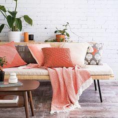 peach throw blanket and pillows on modern sofa, white painted brick wall, pantone blooming dahlia, coral peach, salmon pink Modern Vintage Decor, Modern Boho, Painted Brick Walls, Closet Colors, Interior Styling, Interior Decorating, Decorating Ideas, Decor Ideas, Interior Design Inspiration