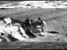 Two Figures Check Out Crashed UFO On Mars, is is footage captured from the live NASA feed before they could remove and 'scrub' the video. What are they not telling us?