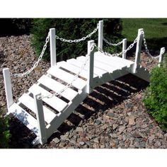 Prairie Leisure 4-ft. Chain Rail Decorative Garden Bridge Color - Black by PRAIRIE LEISURE. $219.99. For decorative use only. Rails connected by curving chain. Decorative garden bridge shown here in white Constructed of solid Aspen wood. Dimensions: 52L x 14W x 21H inches. Available in a variety of finishes to suit your tastes. Enhance the beauty and character of your yard with the Prairie Leisure 4-ft. Chain Rail Decorative Garden Bridge. Avai...