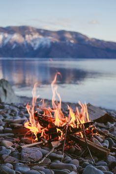 a camp fire by a lake - wonderful way to enjoy the outdoors
