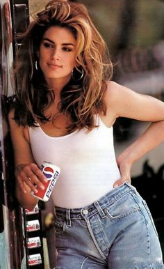 19 stylish ways to wear denim shorts this summer: the high-waisted way with a white tank top a la Cindy Crawford's iconic Pepsi commercial