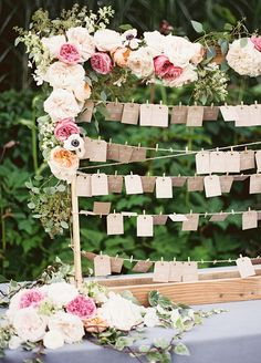 For a vintage feel, have your guests pluck their escort cards from a homemade clothesline hanging from a wooden frame.